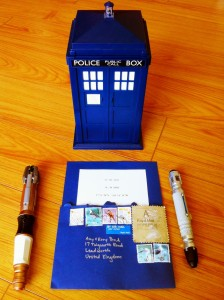 A TARDIS, two sonic screwdrivers, and Amy's invitation from The Impossible Astronaut