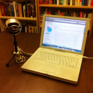 A Blue Snowball microphone and a laptop open to PrePopCulture on iTunes